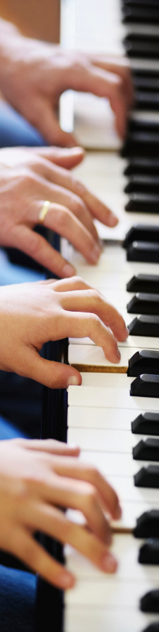 Piano keyboard with four hands